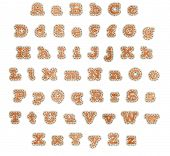 Upper and lower case alphabet in orange fabric patches with brown stitching and beige outline clippi