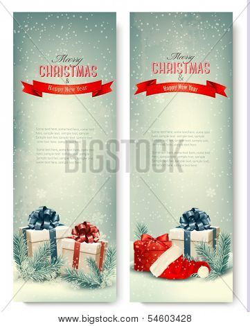 Two retro holiday banners with gift boxes and ribbons. Vector