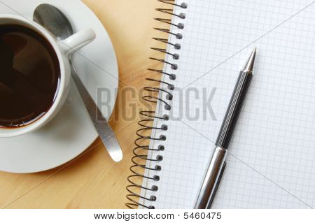 Desk With Coffee And Notebook