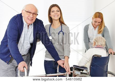 Nursing service with two women for senior couple at home