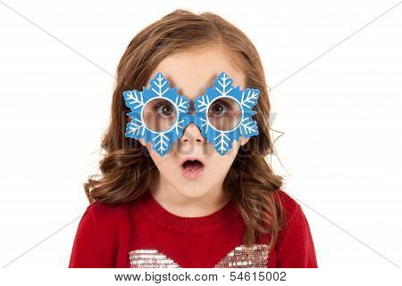 Girl With Funny Expression In Snowman Glasses