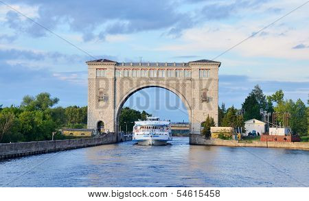Sluice Gates On The River Volga, Russia With Cruise Boat