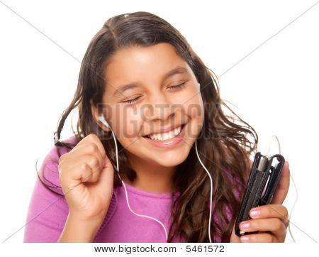 Pretty Hispanic Girl Listening To Music