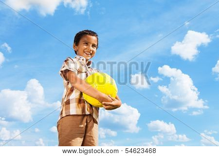 Boy Standing With Football Ball