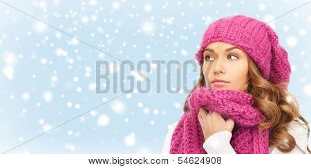 winter, people and happiness concept - beautiful woman in pink winter hat and muffler