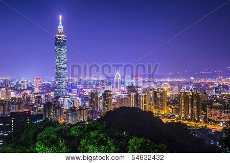 Modern office buildings in Taipei, Taiwan at night.