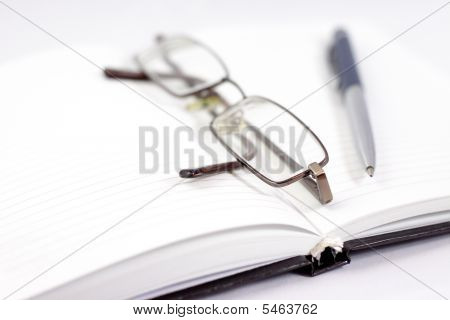 Notebook With The Handle And Glasses