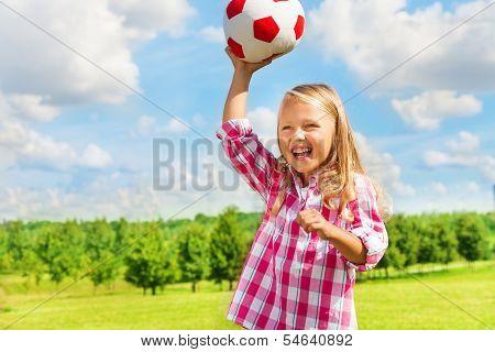 Laughing Girl Throwing Ball