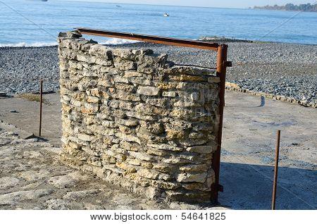 Stone wall on the beach