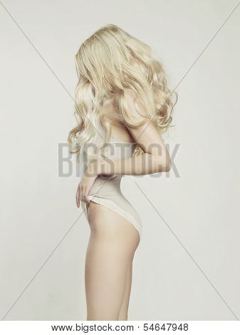 Fashion portrait of young beautiful woman. Sexy blonde