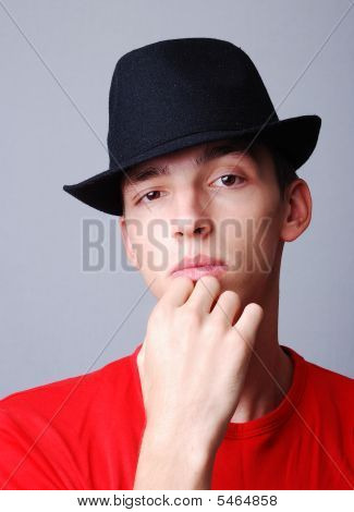 Young Model With Hat On Head And Thinking Expression