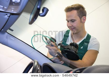 Glazier Repairing Stone-chipping Damage On Car's Windshield