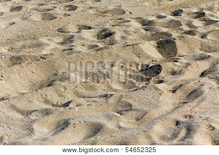 beautiful sand background with foot prints, close up