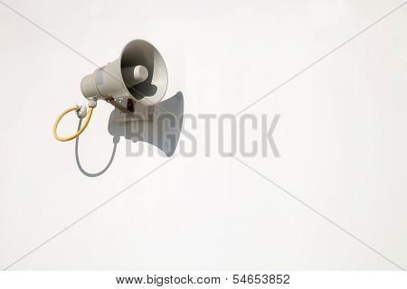 Speaker on a white wall