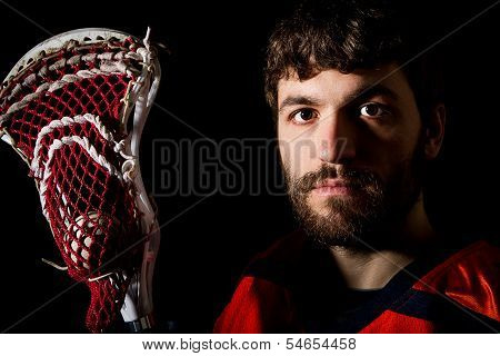 Lacrosse player holding stick with ball.