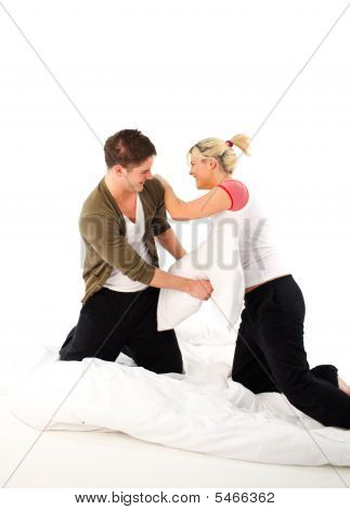 Couple Having Fighting In Bed With Pillows