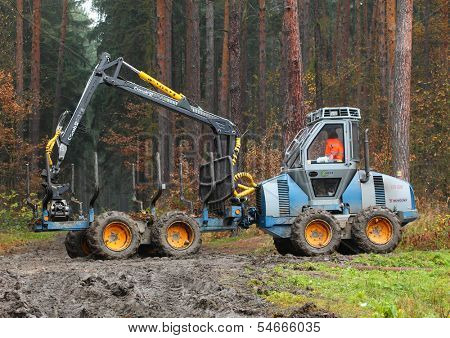 PILSEN CZECH REPUBLIC - NOVEMBER 13: unidentified lumberjack with modern harvestor working in a forest on November 13, 2013. Forestry is Czech's traditional industry with a very long history.