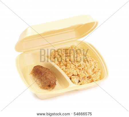 meat rissoles with rice in food container