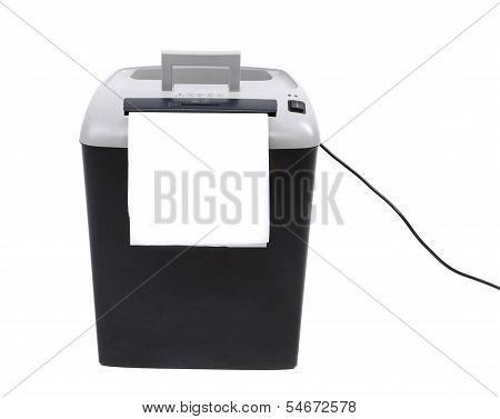 paper shredder against plain background
