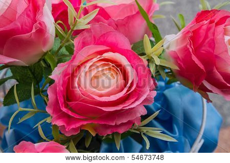 Artificial roses in flower pot