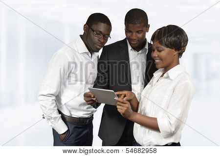 African Business People Discussing With Tablet Pc