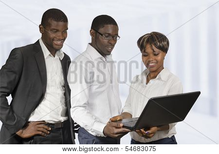 African Business People Discussing Notebook