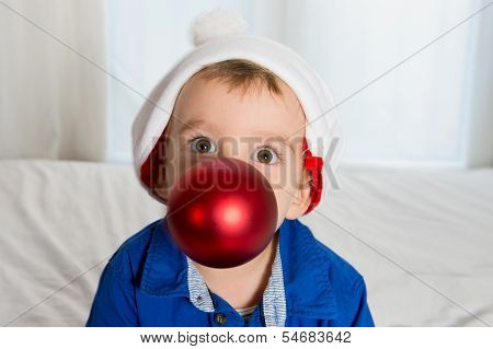 Cuttle Little Kid In Santa Claus Hat Playing With Christmas Bubble