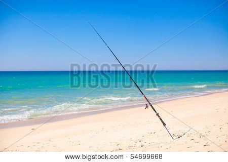 Fishing Rod In White Sand On Tropical Beach, Portugal