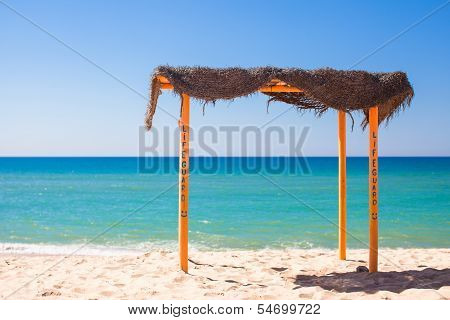 Small Canopy At Empty Tropical Beach On The Atlantic Coast