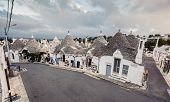 stock photo of conic  - Typical trulli houses with conical roof in unesco world heritage Alberobello - JPG