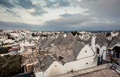pic of conic  - Typical trulli houses with conical roof in unesco world heritage Alberobello - JPG