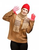 picture of buff  - Young smiling woman in brown sweater buff scarf red cap and gloves standing isolated on white background - JPG