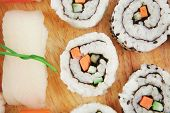 Maki Sushi and Nigiri - California Maki Roll made of fresh raw Salmon, Cream Cheese and Avocado insi