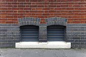 stock photo of inlet  - Two ventilation inlets at brick building exterior - JPG