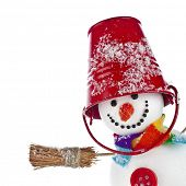 foto of broom  - Cheerful snowman with red color bucket on his head and broom in hand isolated on white background - JPG