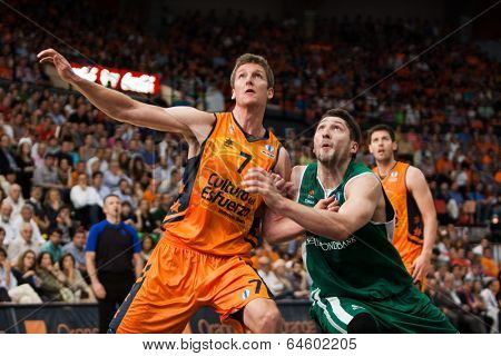 VALENCIA - MAY, 1: Doellman #7 and Kurbanov fight for rebound during a Eurocup Finals match between Valencia Basket Club and Unics Kazan at the Fonteta Stadium on May 1, 2014 in Valencia, Spain