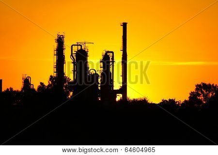 Silhouette Of  Oil Refinery Factory  Against Sunset