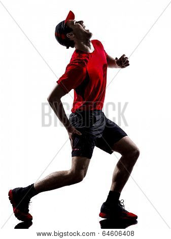 one young man runners joggers running injury pain cramps in silhouettes isolated on white background