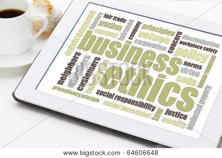 business ethics word cloud on a digital tablet with a cup of coffee
