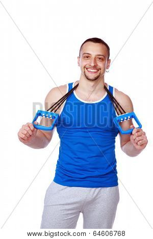 Happy muscular sportsman with expanders over white background