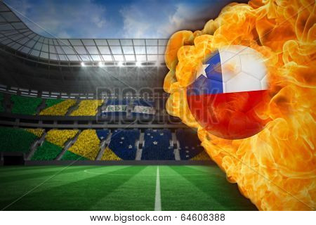 Composite image of fire surrounding chile flag football against large football stadium with brasilian fans