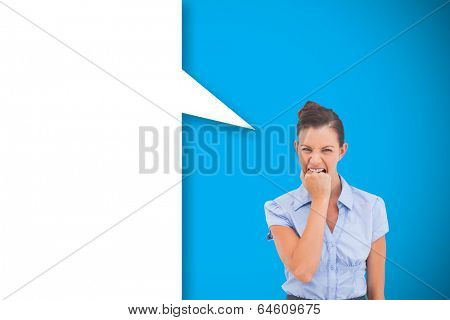 Furious businesswoman with speech bubble against blue background with vignette