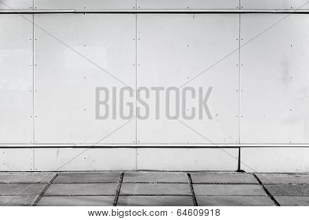 Urban Background Interior With White Metal Wall And Concrete Pavement