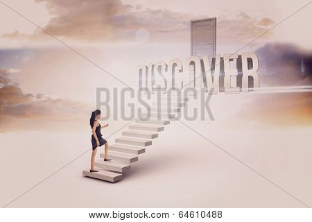 The word discover and businesswoman stepping up white steps leading to closed door