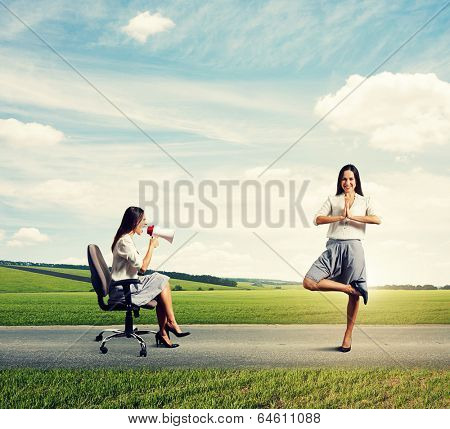 angry businesswoman screaming at big calm woman on the road