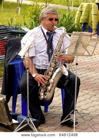 BUDYONNOVSK, STAVROPOL REGION, RUSSIA - MAY 1, 2014: saxophonist from municipal brass band on the Labor Day celebration, on 1st of May 2014, in Budyonnovsk, Russia.