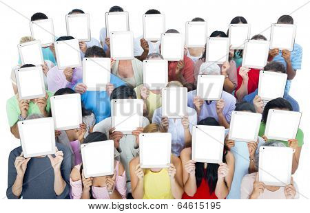 Multi-ethnic casual people holding tablets covering there faces.