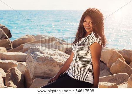 Girl Standing By The Sea