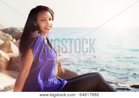Gorgeous Girl Relaxing By The Sea