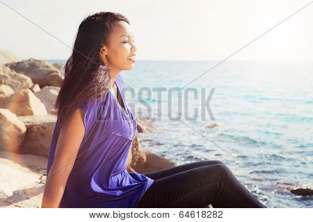Beautiful Girl Relaxing By The Sea